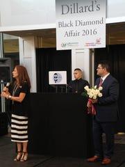 Lisa Hutty, Dillard's store manager; Brandon Rivera, DJ Bodega; and Daniel Santos, Dillard's event coordinator