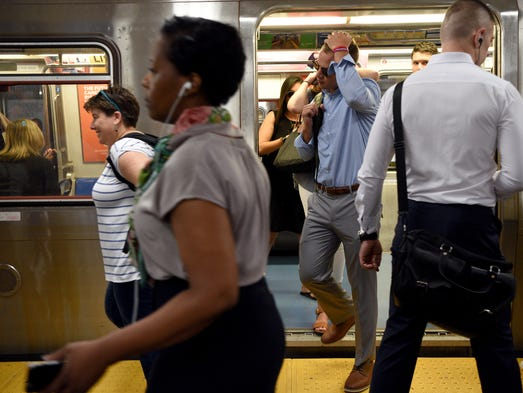 Commuters arrive at the 33rd St. Path in Manhattan