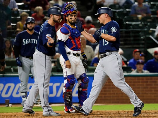 Seattle Mariners' Yonder Alonso congratulates Kyle