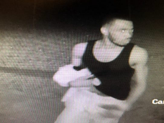 Surveillance video still photo of man wanted for his