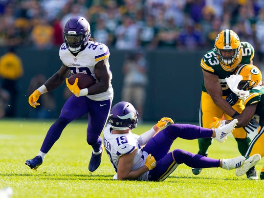 Sep 16, 2018; Green Bay, WI, USA; Minnesota Vikings running back Dalvin Cook (33) rushes with the football during overtime against the Green Bay Packers at Lambeau Field. Mandatory Credit: Jeff Hanisch-USA TODAY Sports