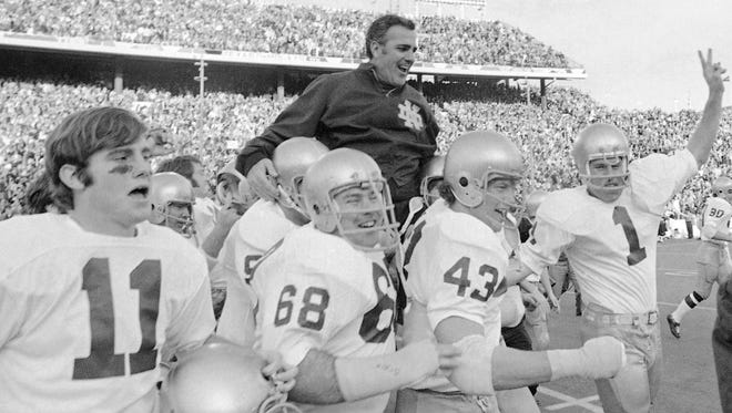 Ara Parseghian is carried off the field by his players after the Irish defeated Texas 24-11 in the Cotton Bowl in Dallas on Jan. 1, 1987.
