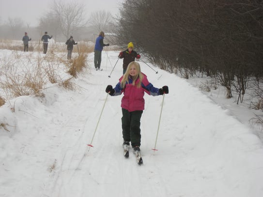 Cross country skiers enjoy the trails at Kuehn Conservation