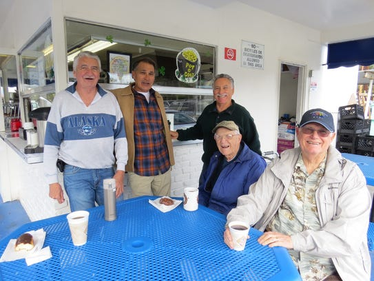 From left, Rolling Pin Donuts regulars Buzz Burns,