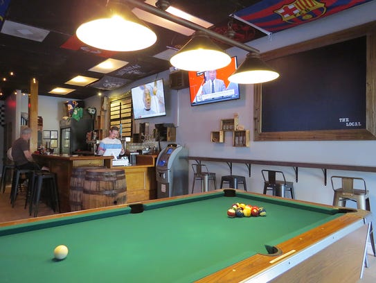 Large-screen TVs and a refurbished billiards table