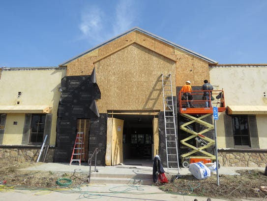 Workers are seen April 24 at the Ventura location of
