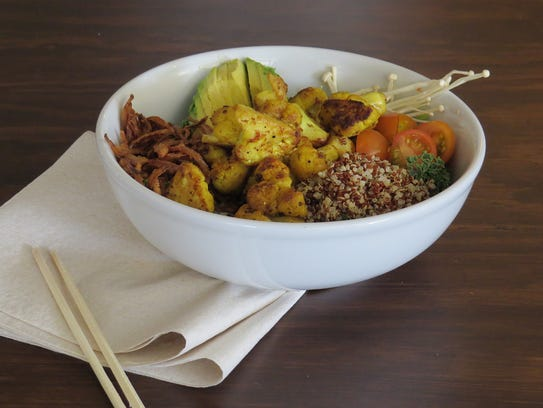 Turmeric-dusted cauliflower is paired with quinoa,