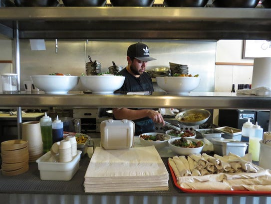 Doug Hernandez, chef and co-owner at Ojai Bowls, prepares