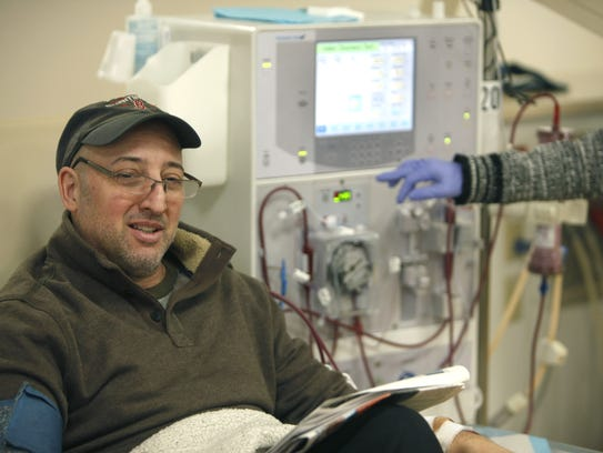 John Vito comes to dialysis with the newspaper and