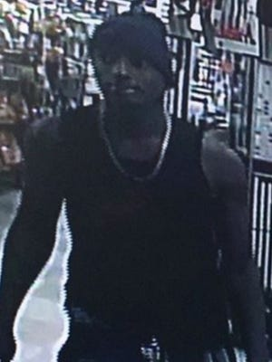 Police are looking for a man who has snatched purses from at least two women at Melbourne convenience stores.