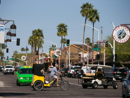 Old Town Scottsdale bustles with tourists from around the Valley and out of state.