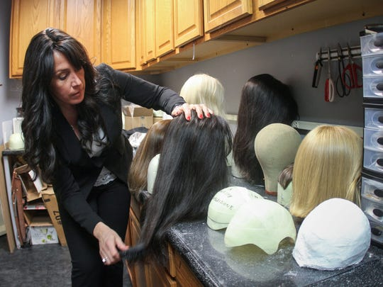 Danielle Grillo owns Transitions Hair Solutions in Wall, which helped Malin Mumford get a wig and is following up with a more permanent medical device.