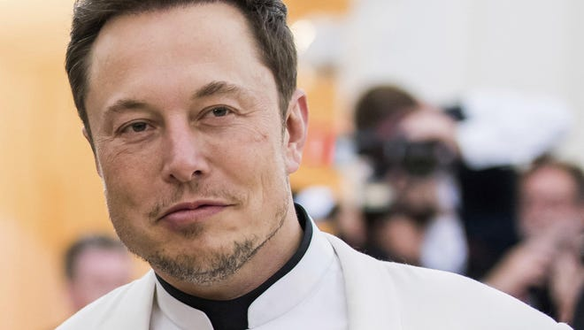 In this May 7, 2018, file photo, Elon Musk attends The Metropolitan Museum of Art's Costume Institute benefit gala celebrating the opening of the Heavenly Bodies: Fashion and the Catholic Imagination exhibition in New York.