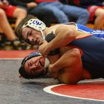 Catholic Central's Conor Cox (top) takes control en route to a pin in his 171-pound match against Franklin's Andres Garza.