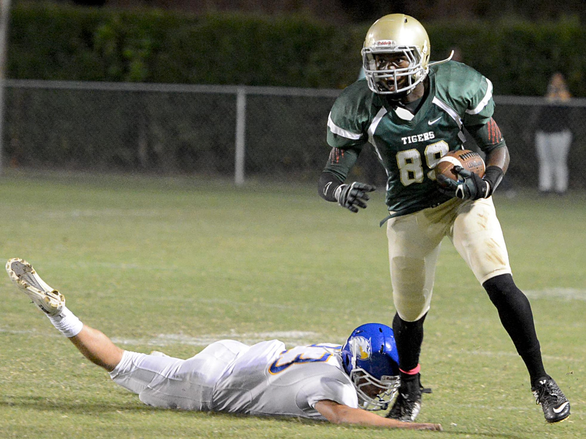 Bolivar's Javonte Crisp avoids a tackle from a Jackson Christian defender in a game last season.