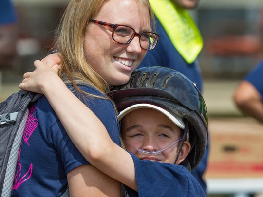 Damon, 12, hugs Alexis Deramo. Kay's Kamp, Delaware's first oncology camp for kids living with cancer, has seen the number of campers more than quadruple over the past five years, from 11 to 47.