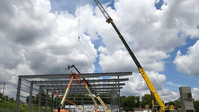Steel girders are placed for the new Stark County campus of the Akron-Canton Regional Foodbank. The future warehouse and food pantry on Cherry Avenue NE is expected to be done the summer of 2021.