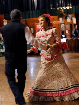 Sherry Gilmore dances with Daniel Johnson at the Texas Cowboys' Christmas Ball in Anson in 2015. This was the 130th anniversary of the dance with many participants attending in period clothing from the 1880s.