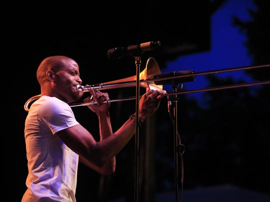 Trombone Shorty plays the East and Alexander St stage during the Xerox Rochester International Jazz Fest 2013.