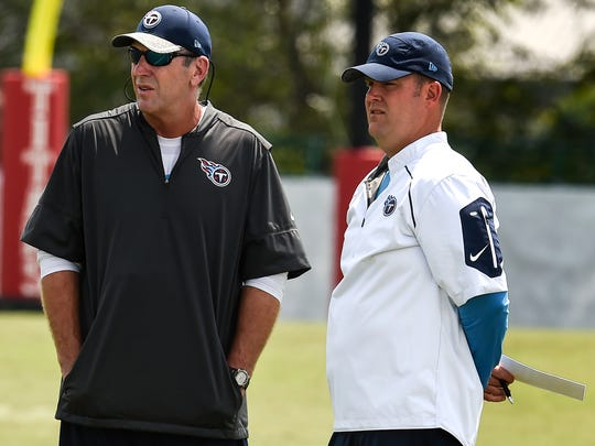 Titans coach Mike Mularkey, left, and general manager