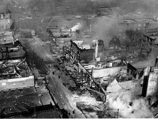 Two days after the assassination of Martin Luther King Jr., buildings smoulder after arsonists and looters rioted in Chicago, Ill, on April 6, 1968.