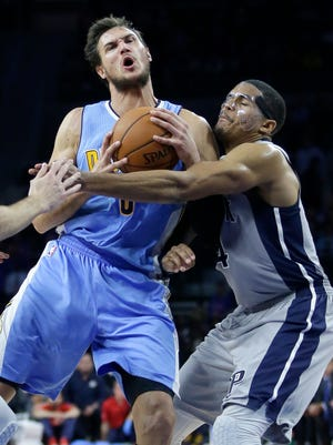 Denver Nuggets' Danilo Gallinari is fouled by Detroit Pistons' Tobias Harris while going to the basket during the second half Nov. 5, 2016, in Auburn Hills.