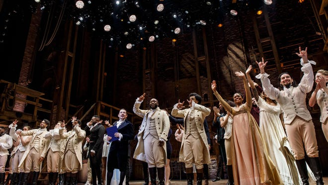 "Miguel Cervantes and the cast of ""Hamilton"" take a curtain call after the final production of the show in Chicago Jan. 5 at the CIBC Theatre."