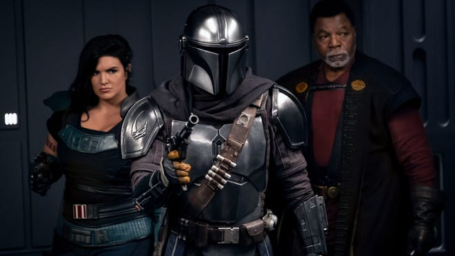 "From left, Gina Carano, Pedro Pascal and Carl Weathers star in Season 2 of ""The Mandalorian."""