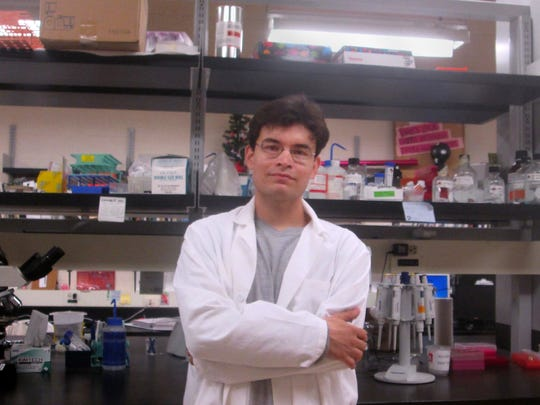 New Mexico State University alum Cesar Montelongo stands in the laboratory where he worked on his master's degree in biology with a minor in molecular biology. He is currently in the M.D.-Ph.D. program at Loyola University Stritch School of Medicine in Chicago.
