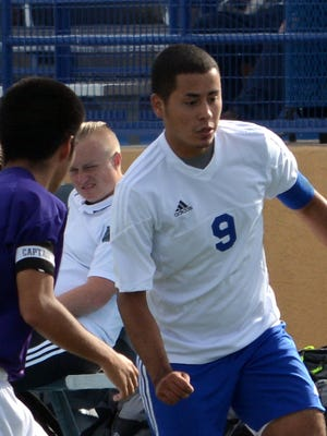 Carlsbad senior forward Jesus Estrada dribbles down the left side in the first half Saturday, Oct. 17 against Clovis. Estrada was one of eight seniors on the team in 2015.