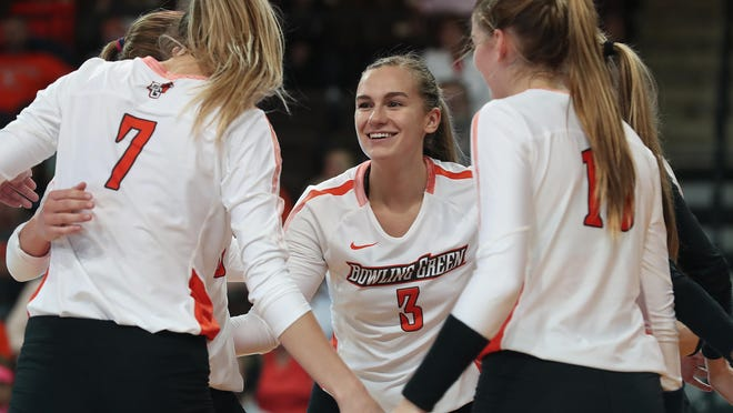 Bedford graduate Isabelle Marciniak celebrates a point with her Bowling Green teammates last season. She is now playing professional volleyball in Germany.