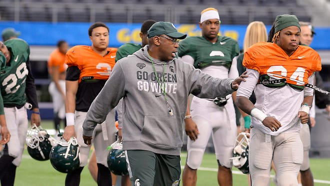 Rod Sanford/Lansing State JournalMSU assistant coach Harlon Barnett (above) works with the secondary as the Spartans practice Sunday for the Cotton Bowl at AT&T Stadium in Arlington, Texas. Next season, Barnett will be a co-defensive coordinator with Mike Tressel, replacing Pat Narduzzi (top left). MSU assistant coach Harlon Barnett works with the defensive secondary as the Spartans practice for the upcoming Cotton Bowl at e AT & T Stadium in Arlington, TX Sunday 12/28/2014. Next season, Barnett will be a co-defensive coordinator with Mike Tressel. Barnett will also be assistant head coach.