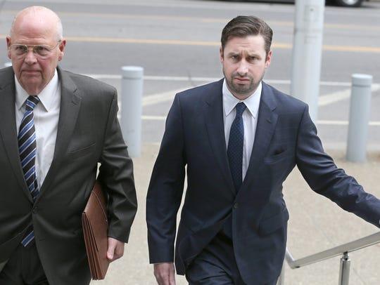 Patrick Ogiony, Buffalo, right, walks into the federal