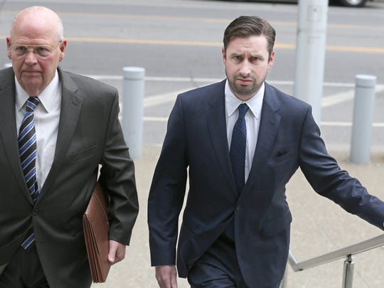 Patrick Ogiony, Buffalo, right, walks into the federal courthouse in Buffalo with his attorney, Joseph LaTona, on May 23, 2018, to face mortgage fraud charges.