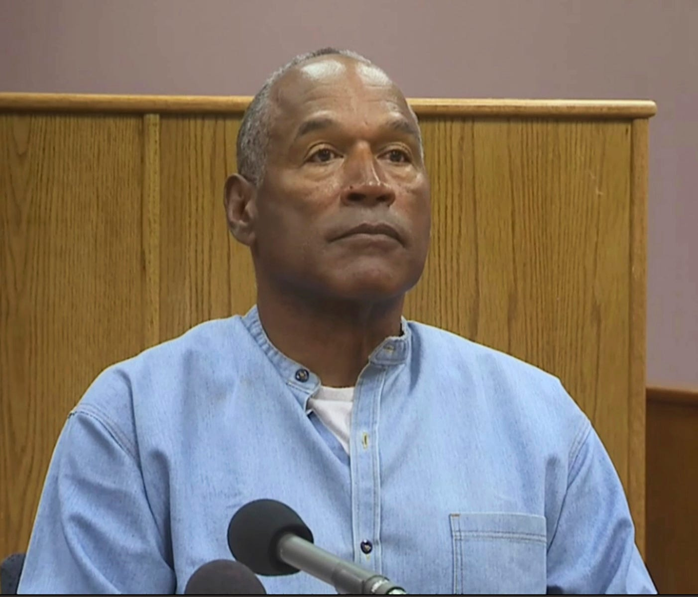 Former NFL football star O.J. Simpson appears via video for his parole hearing at the Lovelock Correctional Center in Lovelock, Nev., on Thursday, July 20, 2017.  Simpson was convicted in 2008 of enlisting some men he barely knew, including two who h