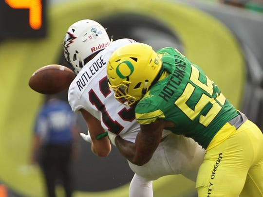 Oregon linebacker A.J. Hotchkins (55) knocks the ball away from Southern Utah receiver Ty Rutledge (13).