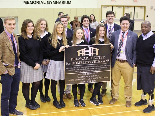 Salesianum, Padua and Ursuline school's student council members join Dave Mosley, far right, executive director of the Delaware Center for Homeless Veterans, to celebrate the opening of DCHV's second home for homeless veterans. Purchase of the eight-bedroom house on Walnut Street in Wilmington was made possible by funding from SALSTHON 2015.