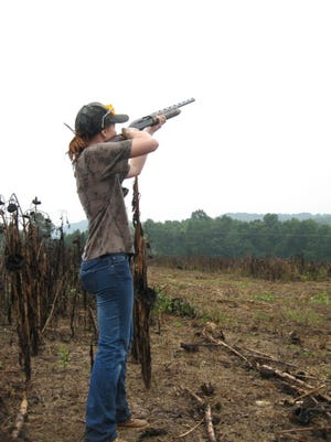 A young hunter demonstrates excellent shotgun form in a Kentucky dove field a few years ago.