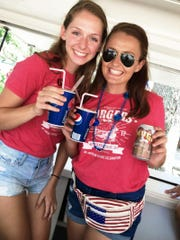 Oliva & Sophie North selling beverages to raise money for United Against Poverty at Burgers & Brews.