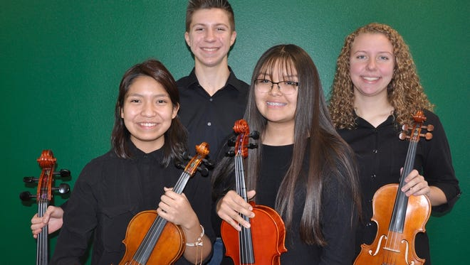 "Shia Deale, left, Max Taulbee, Caitlin Yazzie and Karina Farnsworth of the Farmington High School String Quartet will perform during the ""Beatles vs. Stones -- A Musical Showdown"" production on Jan. 12 at the Farmington Civic Center."