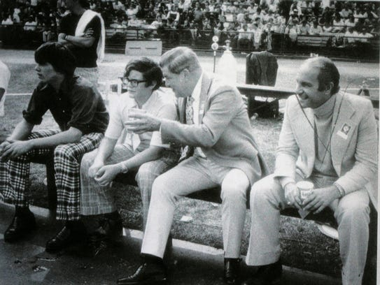 A young Jim Irsay (center) on the sidelines, getting