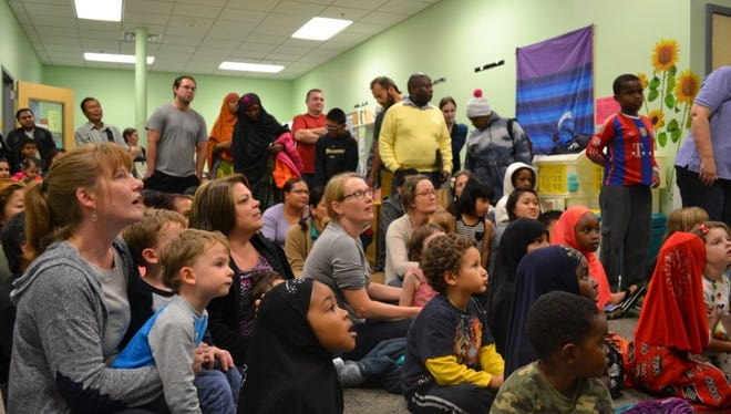 Children and families listen to CLiF Executive Director Duncan McDougall read a story on Oct. 19, 2016, at the O'Brien Community Center in Winooski.