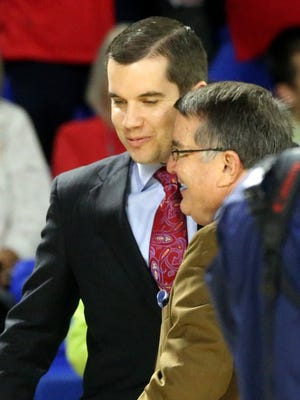 Ole Miss head women's basketball coach Matt Insell, left hugs his dad and opponent MTSU's head women's basketball coach Rick Insell, right before the third round of the 2015 WNIT game on Thursday March 26, 2015, at MTSU.