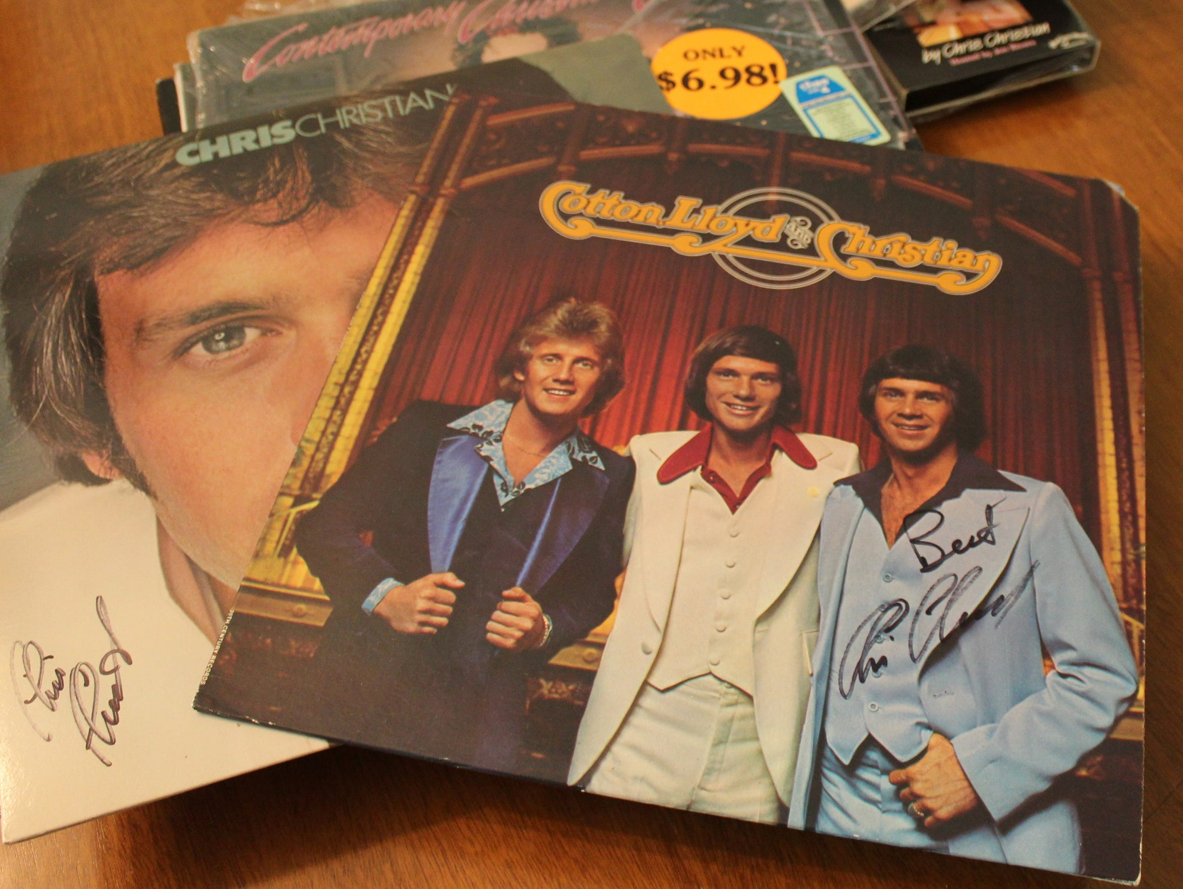 Signed copies of albums by Chris Christian are among