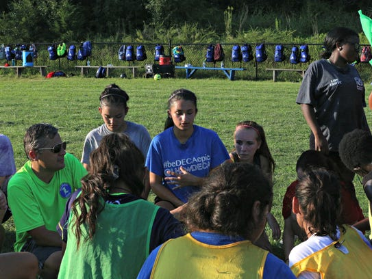 La Vergne girls soccer coach Jamie Shields, left, talks