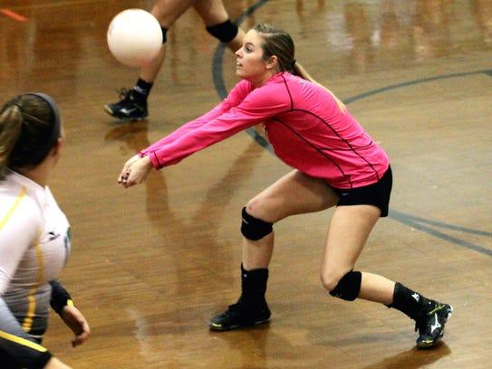 Catholic's Kayla Carrell sets up a shot against Marianna