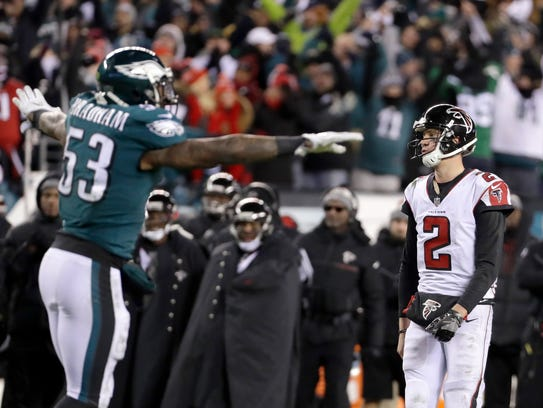 Falcons QB Matt Ryan and Eagles LB Nigel Bradham react after Atlanta failed to score on fourth-and-goal in an NFC divisional playoff game in Philadelphia.