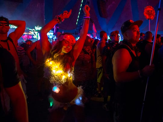 Agnieszka Salamon, from Poland, dances at Neon Garden on the first night of the Electric Daisy Carnival at Las Vegas Motor Speedway Saturday, June 17, 2017, in Las Vegas.