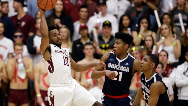 Santa Clara guard KJ Feagin, left, grabs a rebound next to Gonzaga forward Rui Hachimura (21) and guard Zach Norvell Jr. (23) during the first half of an NCAA college basketball game Saturday, Jan. 20, 2018, in Santa Clara, Calif. (AP Photo/Marcio Jose Sanchez)