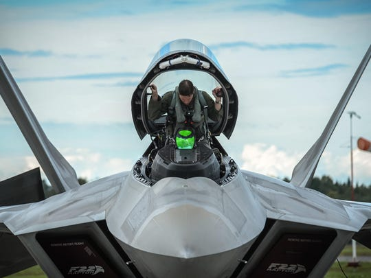A 95th FighterSquadron pilot from Tyndall Air Force Base begins preparations to fly an F-22 Raptor, the Air Force's newest fighter, at Ämari Air Base in Estonia in September.